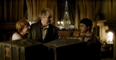 """(L-r) RUPERT GRINT as Ron Weasley, JIM BROADBENT as Professor Horace Slughorn and DANIEL RADCLIFFE as Harry Potter in Warner Bros. PicturesÕ fantasy adventure movie ÒHarry Potter and the Half-Blood Prince."""" NOTE; THIS PHOTO WAS DOWNLOADED BY CONSENTING TO AN AGREEMENT THAT IT WOULD NOT BE USED OUTSIDE THE LOS ANGELES TIMES. WE RECEIVED SPECIAL PERMISSION TO KEEP THIS PHOTO IN OUR DATABASE BEYOND THE STATED 90 DAY RESTRICTION. CAN BE USED ONLY IN EDITORIAL. NO ADS, SALES, ETC. PERMISSION GIVE BY JESSE MESA,WARNER BROS. PHOTO (818) 954-6256."""