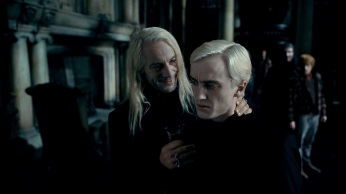 """HP7-1-FP-0624 (L-r) JASON ISAACS as Lucius Malfoy and TOM FELTON as Draco Malfoy in Warner Bros. Pictures' fantasy adventure """"HARRY POTTER AND THE DEATHLY HALLOWS – PART 1,"""" a Warner Bros. Pictures release. Photo courtesy of Warner Bros. Pictures"""