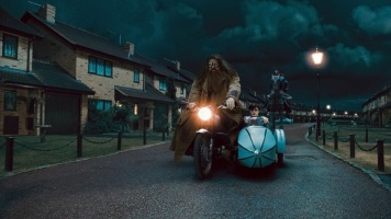 """HP7-1-FP-0093(L-r) ROBBIE COLTRANE as Rubeus Hagrid and DANIEL RADCLIFFE as Harry Potter in Warner Bros. Pictures' fantasy adventure """"HARRY POTTER AND THE DEATHLY HALLOWS – PART 1,"""" a Warner Bros. Pictures release. Photo courtesy of Warner Bros. Pictures"""