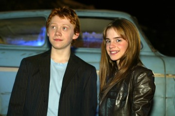 """Rupert Grint and Emma Watson at the Los Angeles premiere of """" Harry Potter and the Chamber of Secrets"""" at the Village Theatre, Thursday, Nov. 14, 2002. Photo by Kevin Winter/ImageDirect."""
